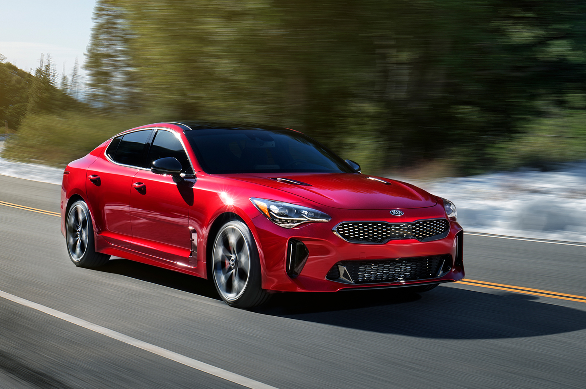 2018-Kia-Stinger-GT-front-three-quarter-in-motion-04.jpg